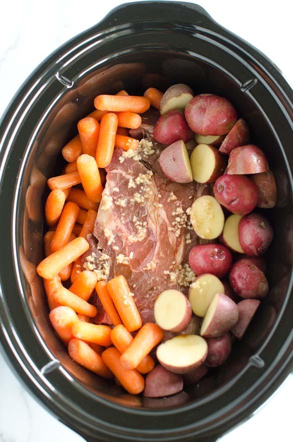 crock pot of roast carrots and potatoes
