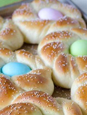 braided Italian Easter bread with dyed eggs in center