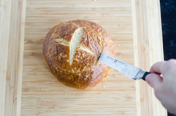 slicing off top of pretzel bun