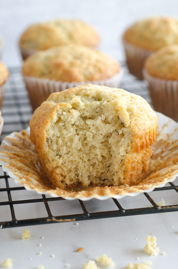 bite of banana muffin on cooling rack