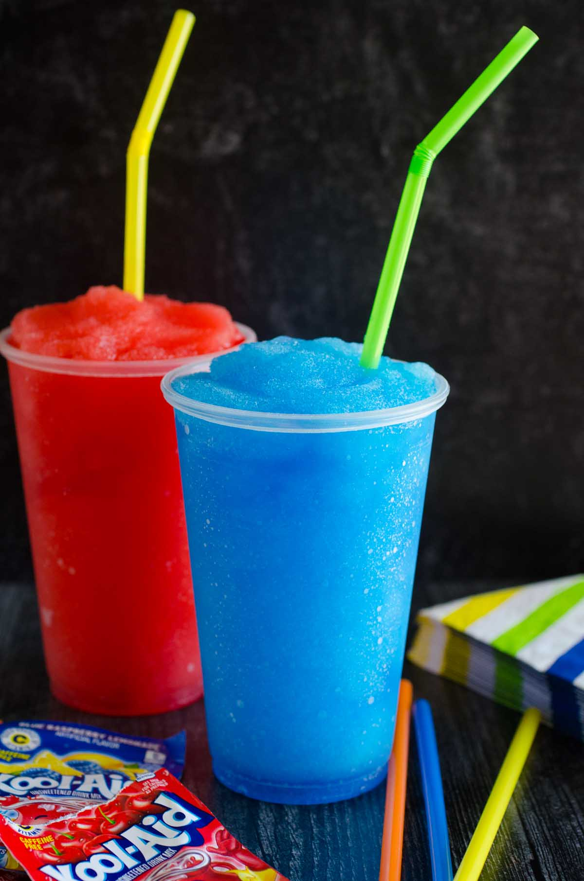 red and blue frozen drinks with straws