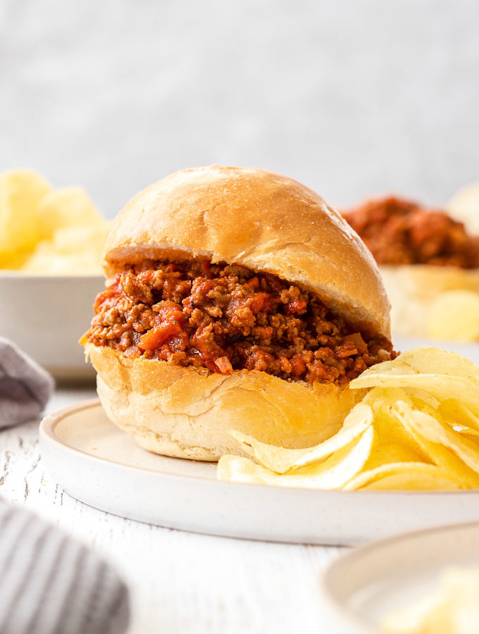 sloppy joe on a plate with chips