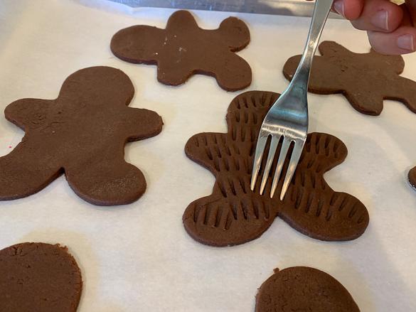 pressing tongs of fork into wookie cookies