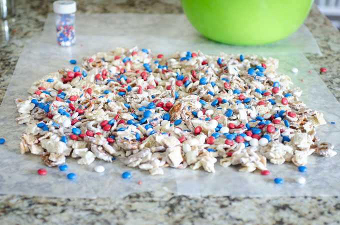 white chocolate chex mix spread on wax paper