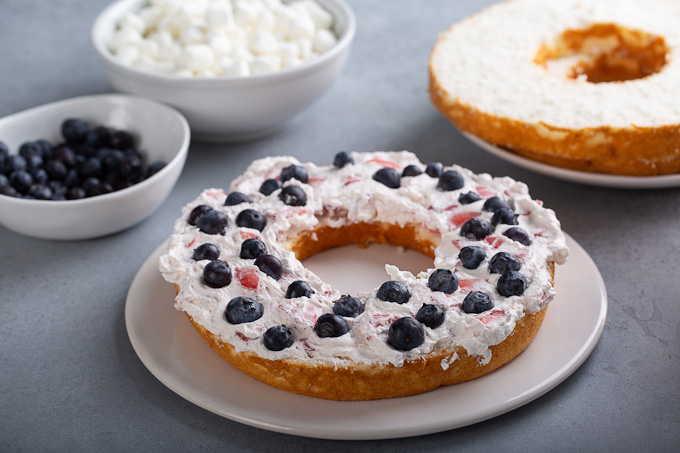 layer of cake with strawberry filling and blueberries