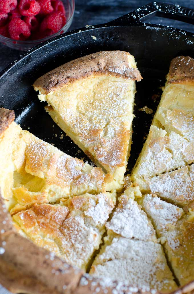 slices of dutch baby pancake in skillet