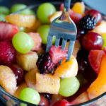 fork in bowl of fruit
