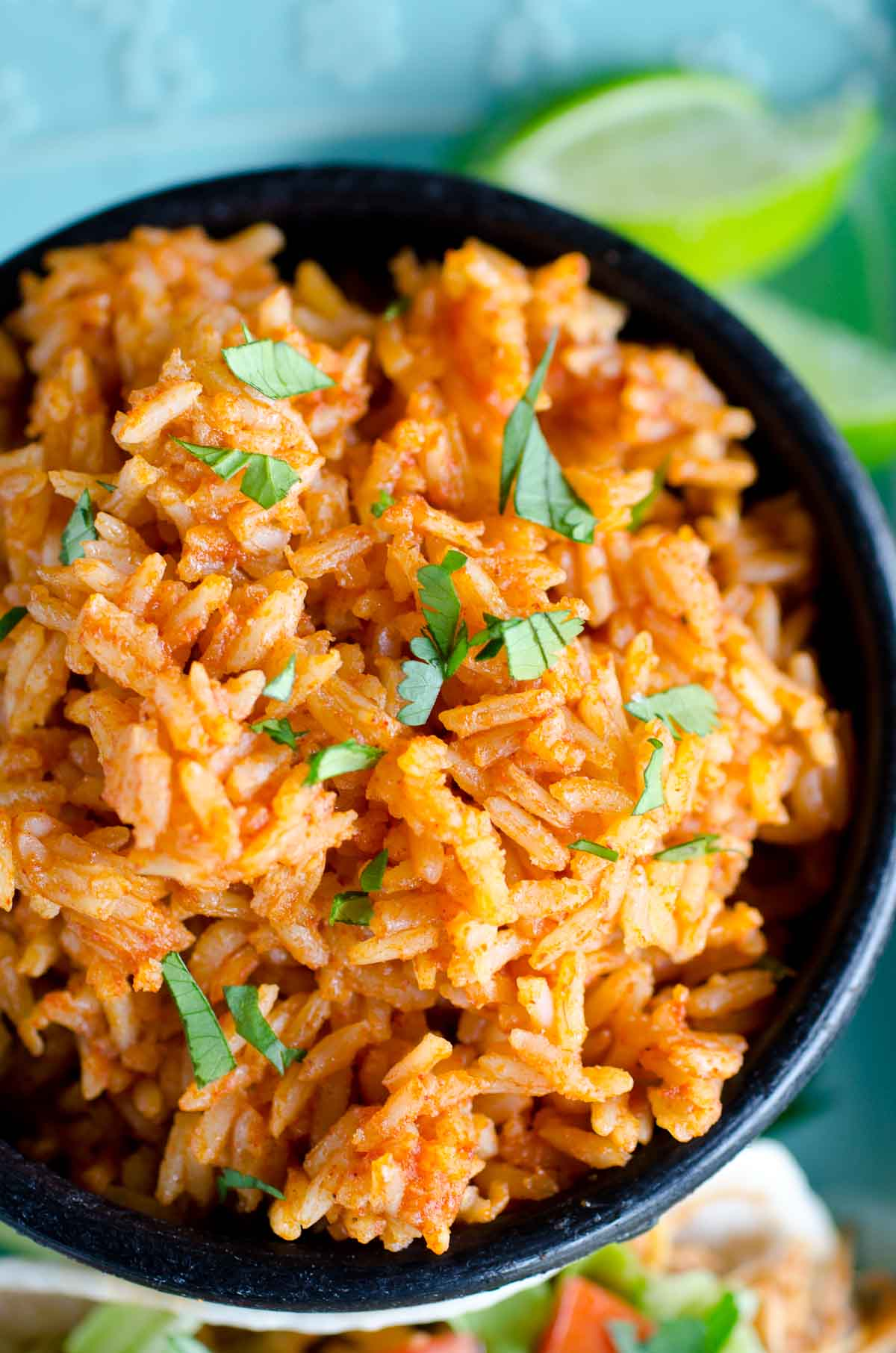mexican rice garnished with cilantro
