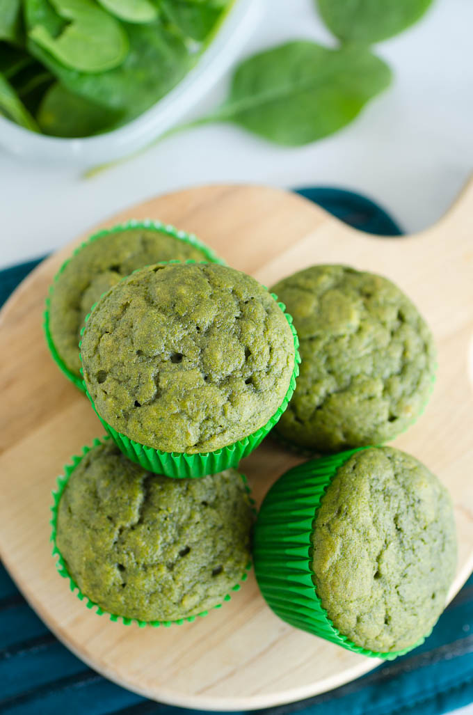 green muffins stacked on cutting board