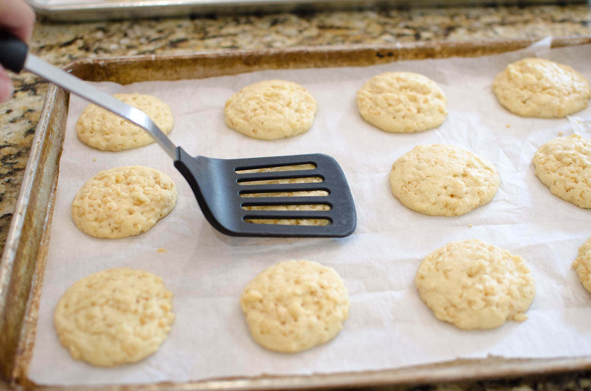 round cookies on baking sheet flattened by spatula