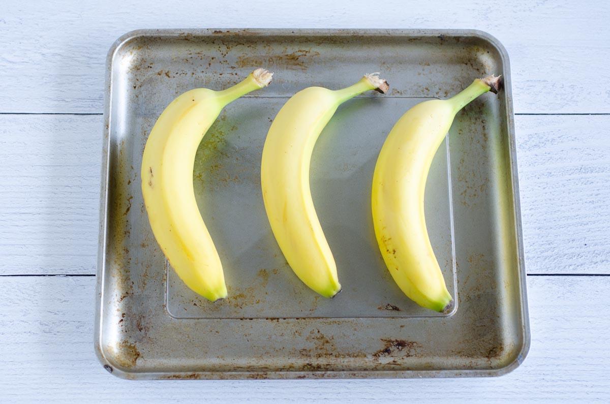 three bananas on a baking sheet