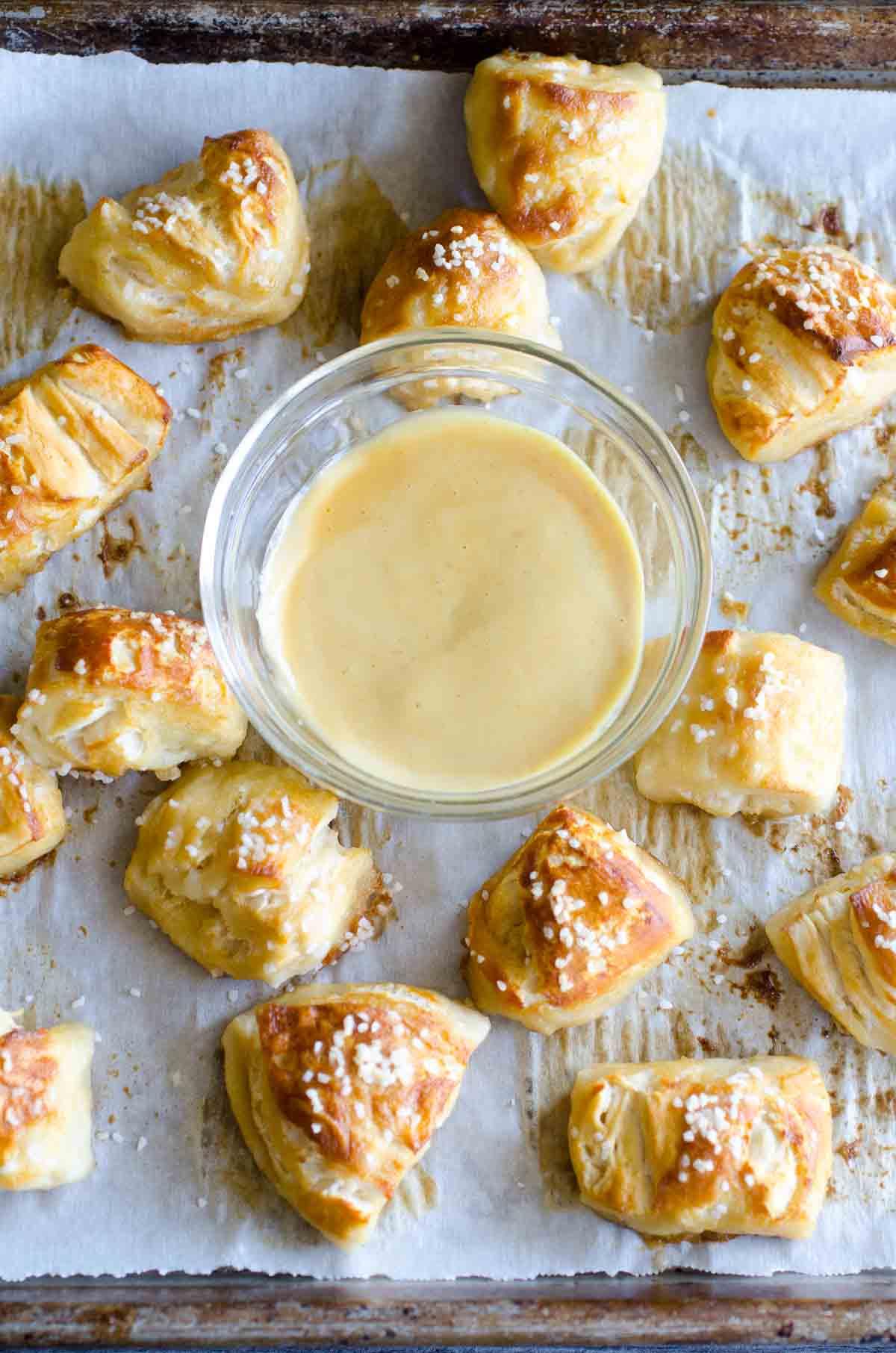 soft pretzel bites around mustard sauce in small bowl