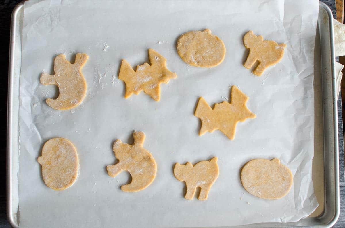 halloween shaped cookies on baking sheet