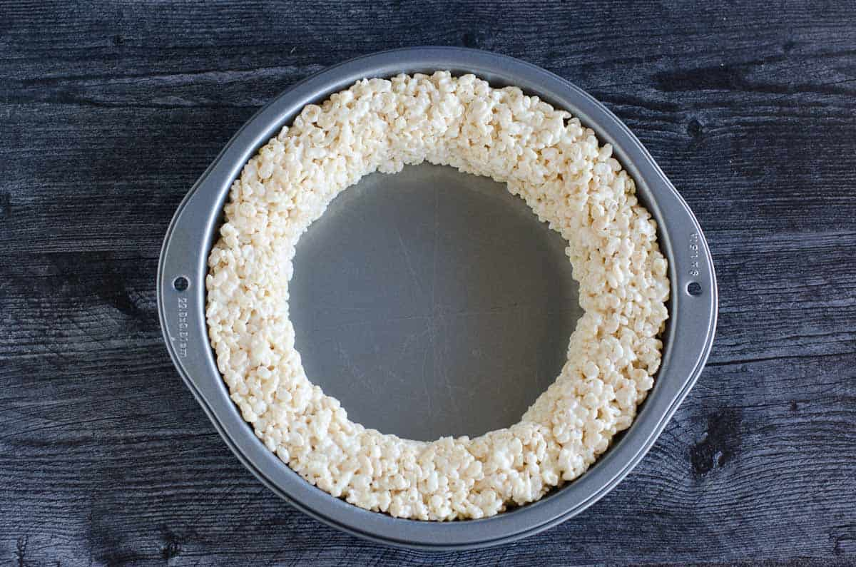 marshmallow krispies pressed into edges of round cake pan