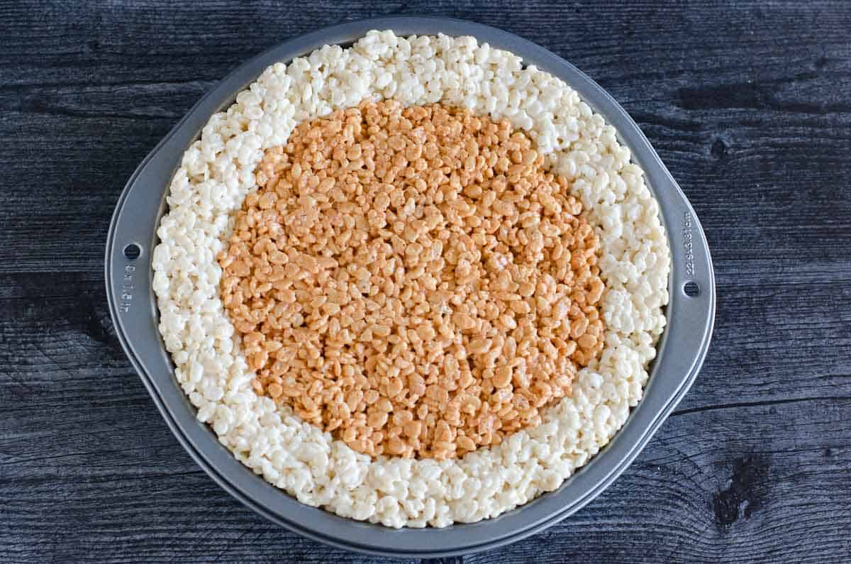 marshmallow krispies pressed into pan with apperance of pumpkin pie colors