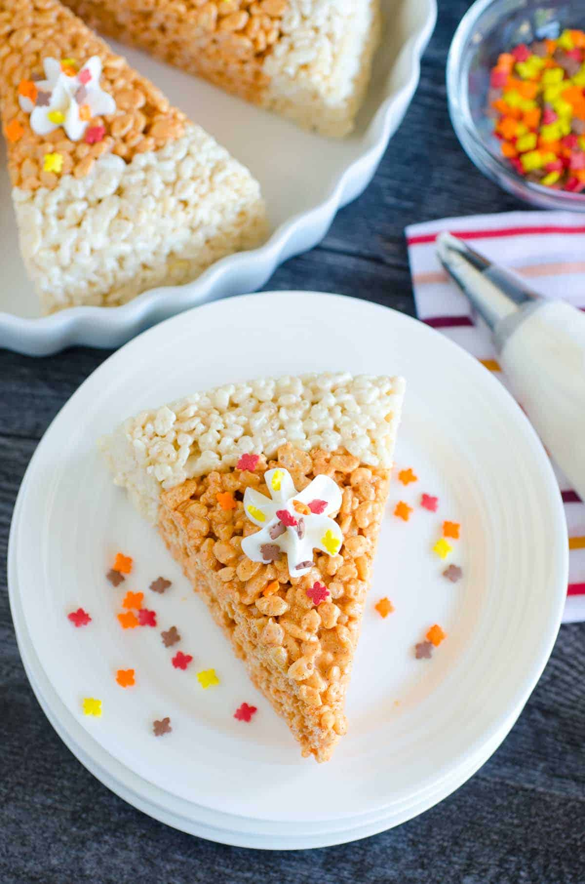 rice krispies treat that looks like a slice of pumpkin pie with frosting and sprinkles