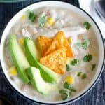 bowl of white chicken chili with toppings