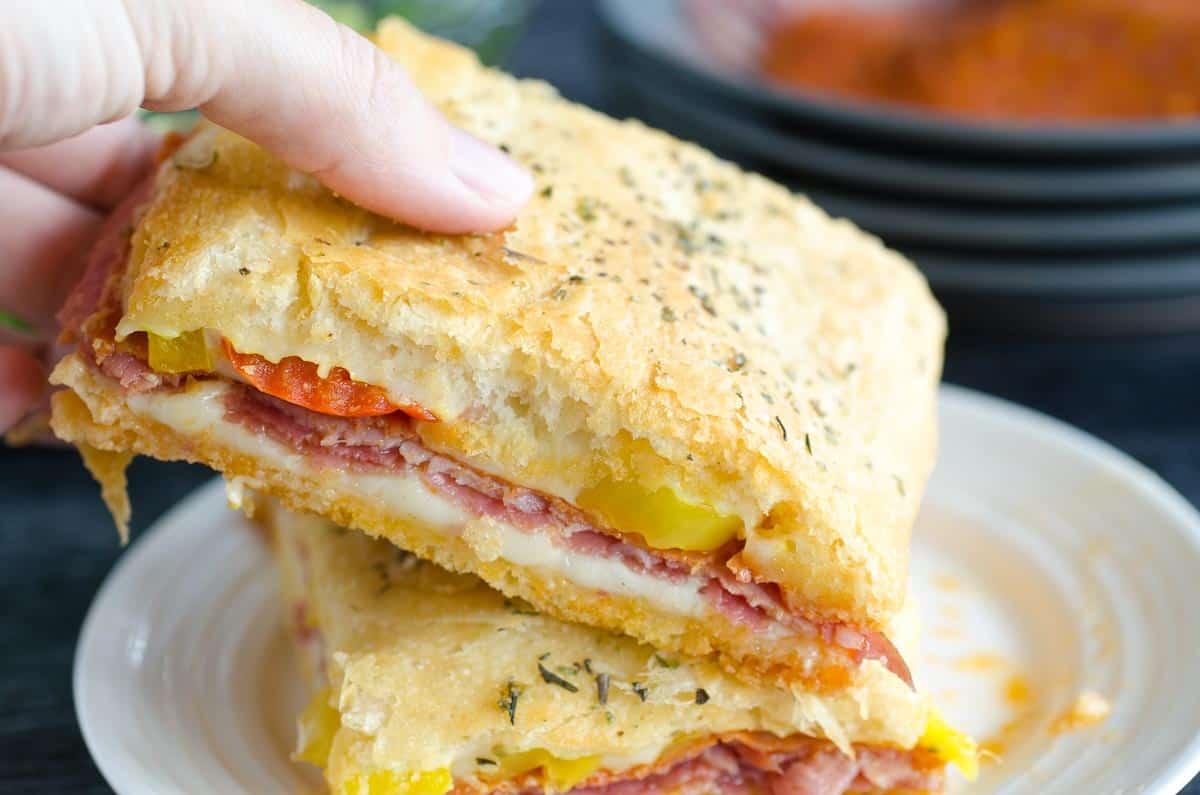 picking up a hot italian sandwich