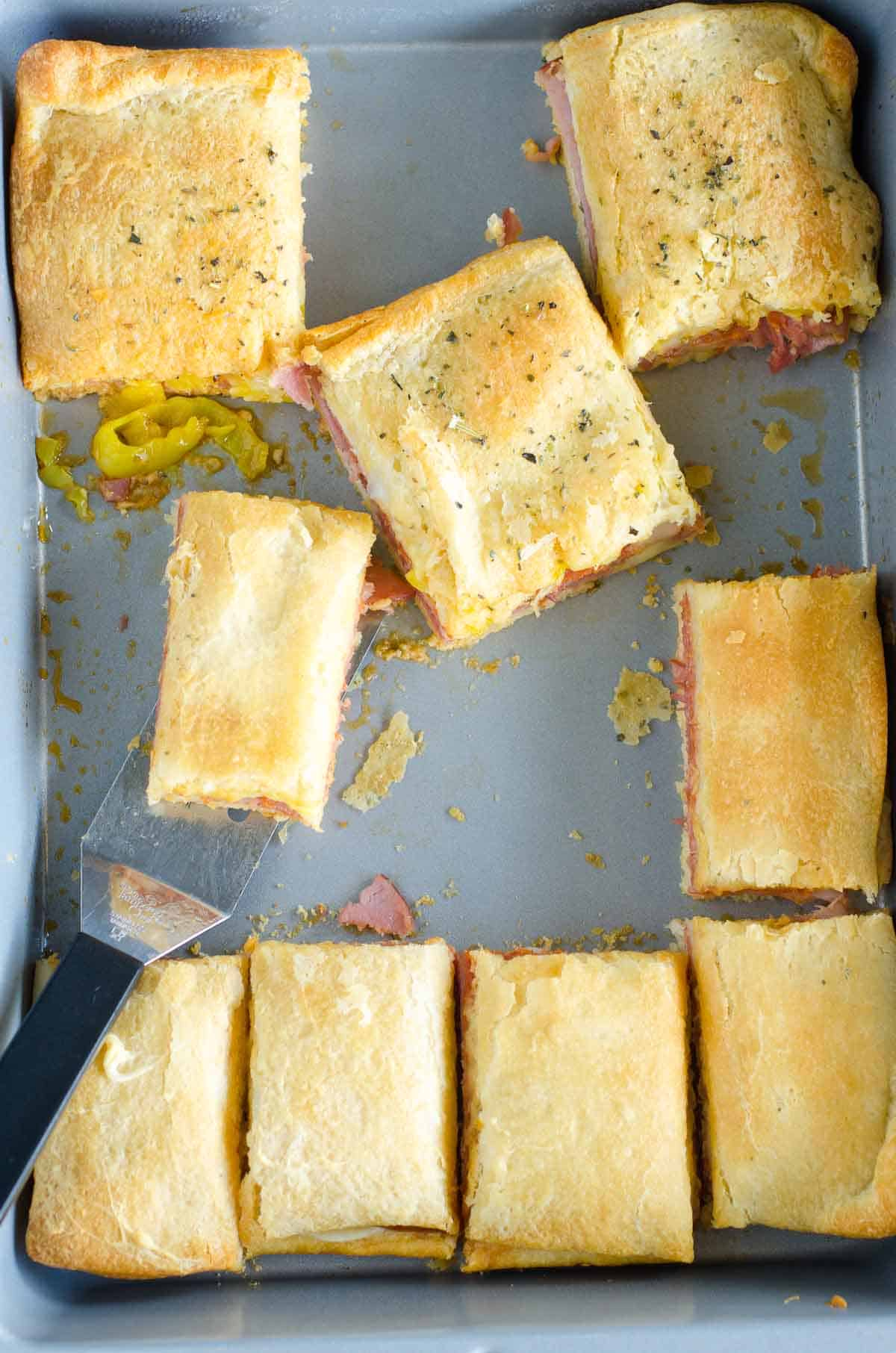 sliced crescent sandwiches in a pan