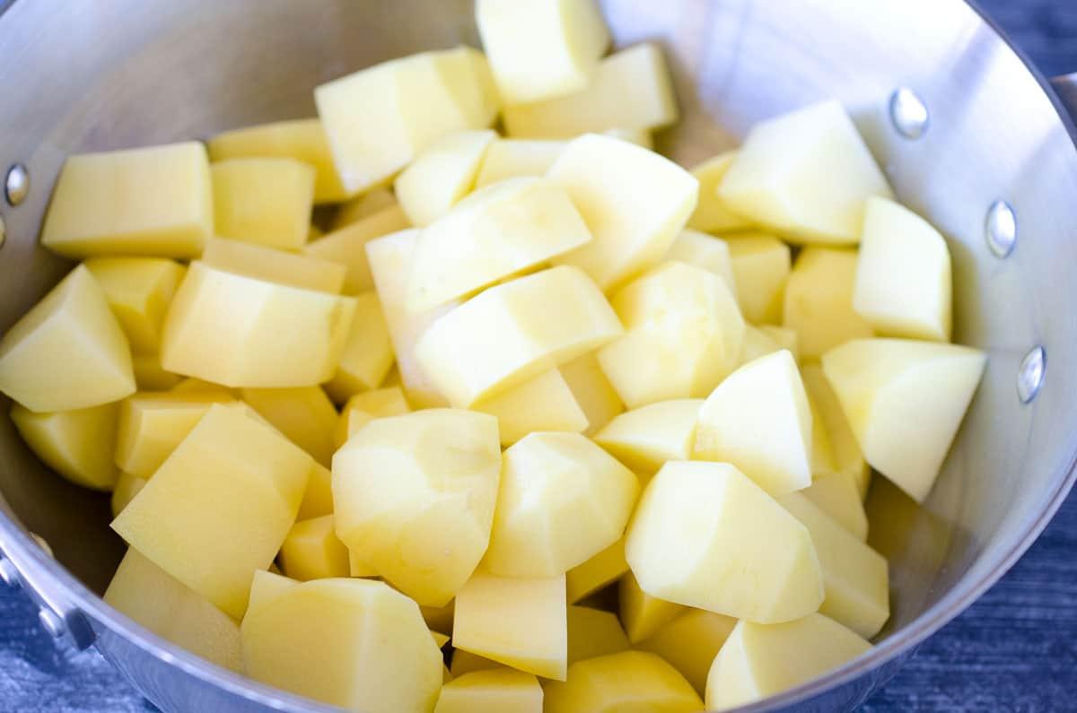 chopped potatoes in a dutch oven