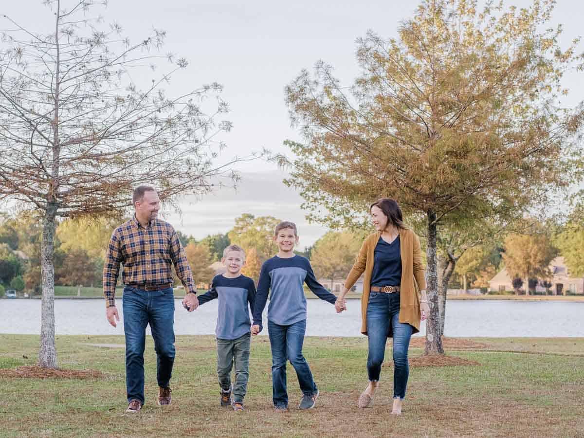 family walking by lake