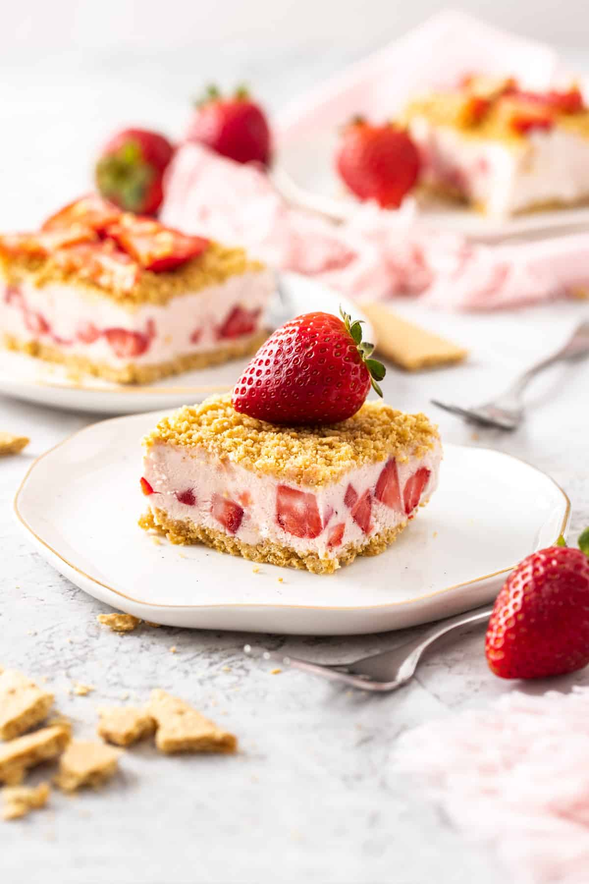 strawberry dessert on a plate topped with a whole strawberry