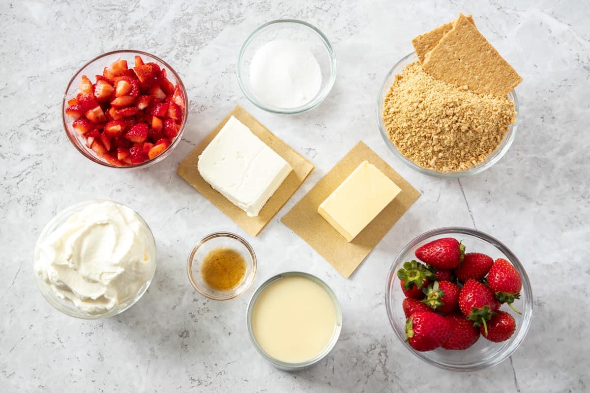 Ingredients to make frozen strawberry dessert