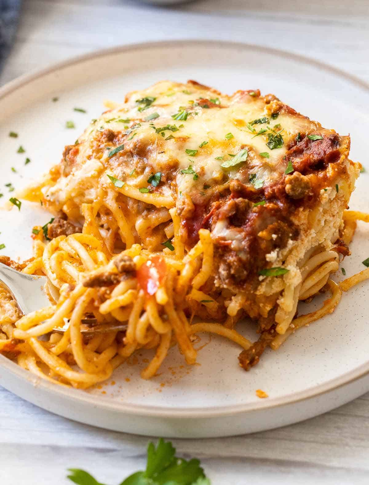 baked spaghetti casserole on a plate with fork