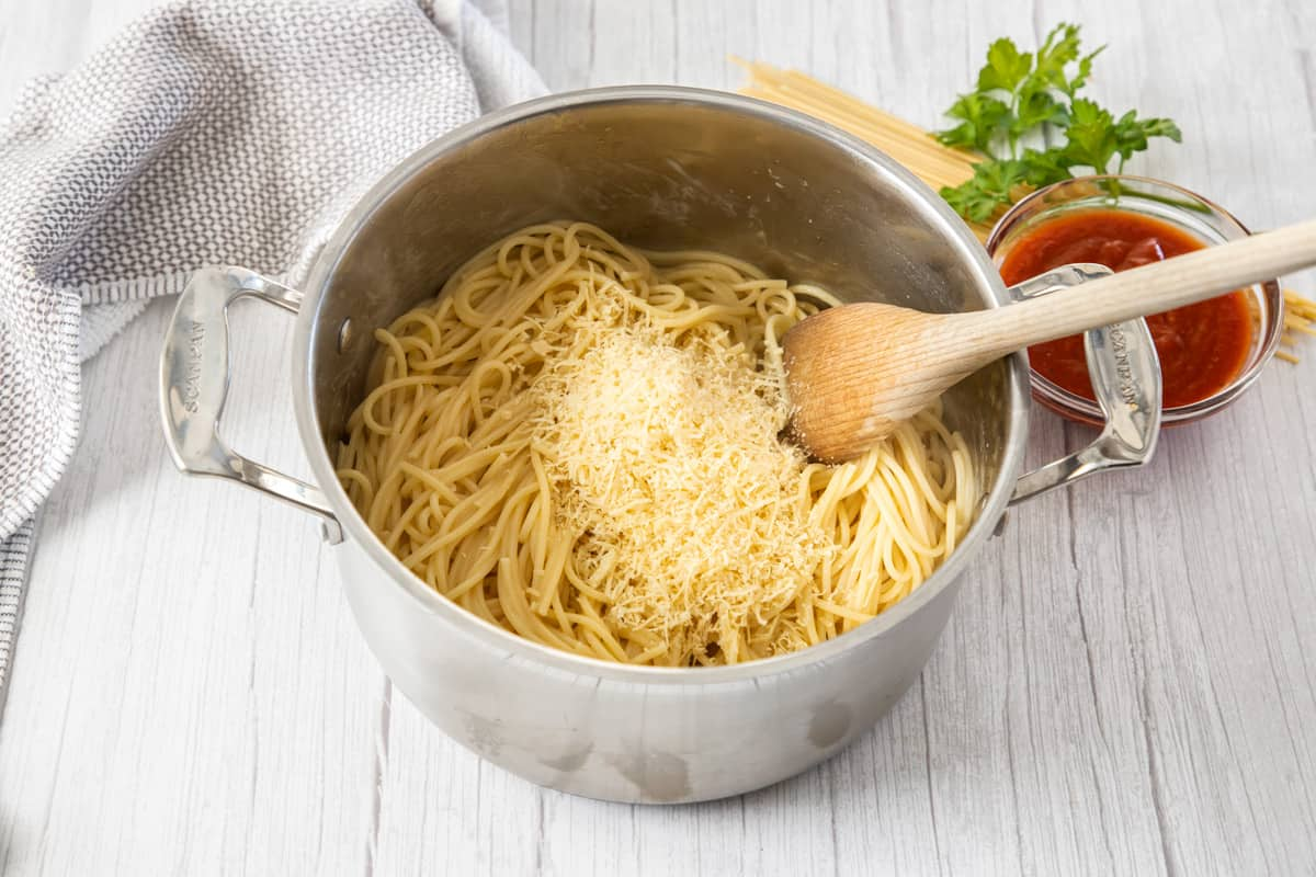 spaghetti is pan with parmesan for baked spaghetti process
